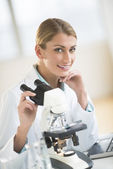 Beautiful Scientist Sitting With Microscope At Desk — Stock Photo
