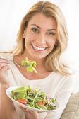 Happy Woman Eating Vegetable Salad — Stock Photo