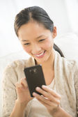 Happy Woman Using Mobile Phone — Stock Photo