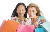 Shopaholic Female Friends Carrying Shopping Bags — Stock Photo