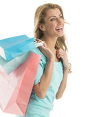 Happy Woman Looking Away While Carrying Shopping Bags — Stock Photo