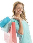 Portrait Of Happy Shopaholic Woman Carrying Shopping Bags — Stock Photo