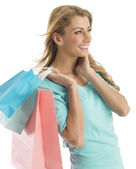 Happy Shopaholic Woman Looking Away While Carrying Shopping Bags — Stock Photo