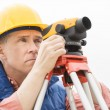 Surveyor Measuring Distances Through Theodolite — Stock Photo