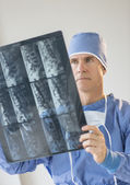 Male Surgeon In Uniform Looking At X-Ray — Stockfoto