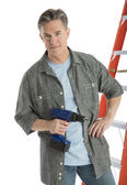 Portrait Of Confident Male Carpenter Holding Drill — Stock Photo