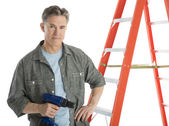 Confident Carpenter Holding Drill While Standing By Ladder — Stock Photo