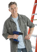 Portrait Of Happy Male Carpenter Holding Drill — Stock Photo