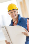 Confident Architect Holding Blueprint At Construction Site — Stock Photo