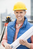 Happy Architect Holding Rolled Up Blueprint — Stock Photo