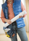 Midsection Of Construction Worker Holding Blueprint — Stock Photo