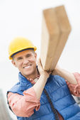 Happy Construction Worker Carrying Wooden Plank — Foto de Stock