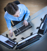 Trader Analyzing Data On Multiple Screens At Desk — Stock Photo