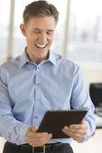 Cheerful Businessman Using Digital Tablet — Stock Photo