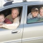 Happy Family Sitting In Car — Stock Photo