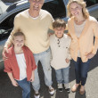 Loving Parents And Children Standing Against Car — Stock Photo
