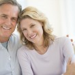 Couple Smiling Together At Home — Stock Photo