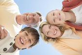 Cheerful Parents And Children Against Clear Blue Sky — Stock Photo