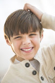 Happy Boy Scratching Head At Home — Stock Photo
