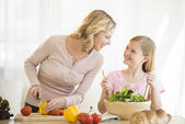 Mother And Daughter Preparing Food In Kitchen — Stock Photo