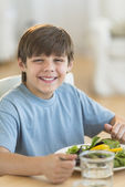 Boy Having Fresh Salad At Dining Table — Stock Photo