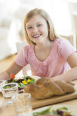 Girl Having Meal At Dining Table — Stock Photo