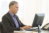 Businessman Using Desktop PC In Office — Stock Photo