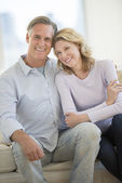 Loving Couple Smiling Together At Home — Stock Photo