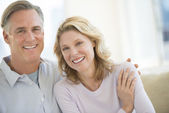 Loving Mature Couple Smiling At Home — Stock Photo