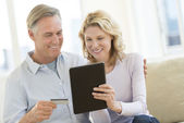 Couple With Credit Card And Digital Tablet Shopping Online — Stock Photo