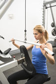 Woman Doing Weight Exercise In Health Club — Stock Photo