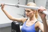 Woman Exercising With Pulley In Gym — Stock Photo