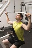 Man Exercising In Health Club — Stock Photo
