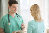 Doctor Explaining Medical Report To Patient In Hospital — Stock Photo