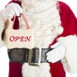 Midsection Of Santa Claus Holding Open Sign — Stock Photo