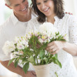 Couple Arranging Flowers In Vase — Stock Photo #30514179