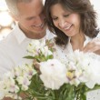 Romantic Couple Arranging Flowers — Stock Photo #30514523