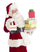Portrait Of Santa Claus With Gifts And Open Sign — Stock Photo