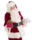 Santa Claus Gesturing While Holding Gift Box — Photo
