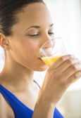 Woman Drinking Fresh Orange Juice At Gym — Stock Photo