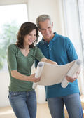 Woman Showing Blueprint To Husband In New House — Stock Photo