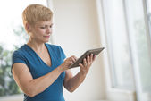 Businesswoman Using Digital Tablet In Office — Stock Photo