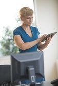 Businesswoman Using Digital Tablet — Stock Photo