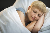 Mature Woman Sleeping In Bed — Stock Photo