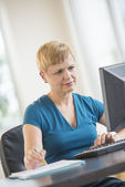 Businesswoman Using Computer At Desk — Stock Photo