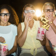 Shocked Teenage Girls Watching 3D Movie In Theater — Stock Photo