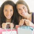 Female Friends Carrying Shopping Bags — Stock Photo