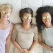 Foto de Stock  : Happy Teenage Girls With Cucumber Slices On Their Eyes