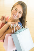Happy Teenage Girl Carrying Shopping Bags — Stock Photo