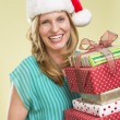Woman Holding Stack Of Christmas Presents — Stock Photo